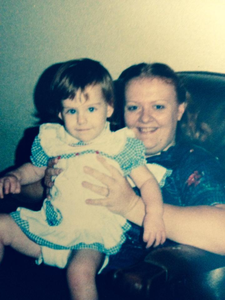 Marilyn holding me as a toddler