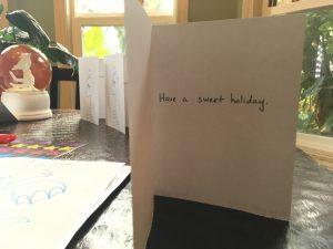 "Lots of cards that say ""Have a sweet holiday"" inside"