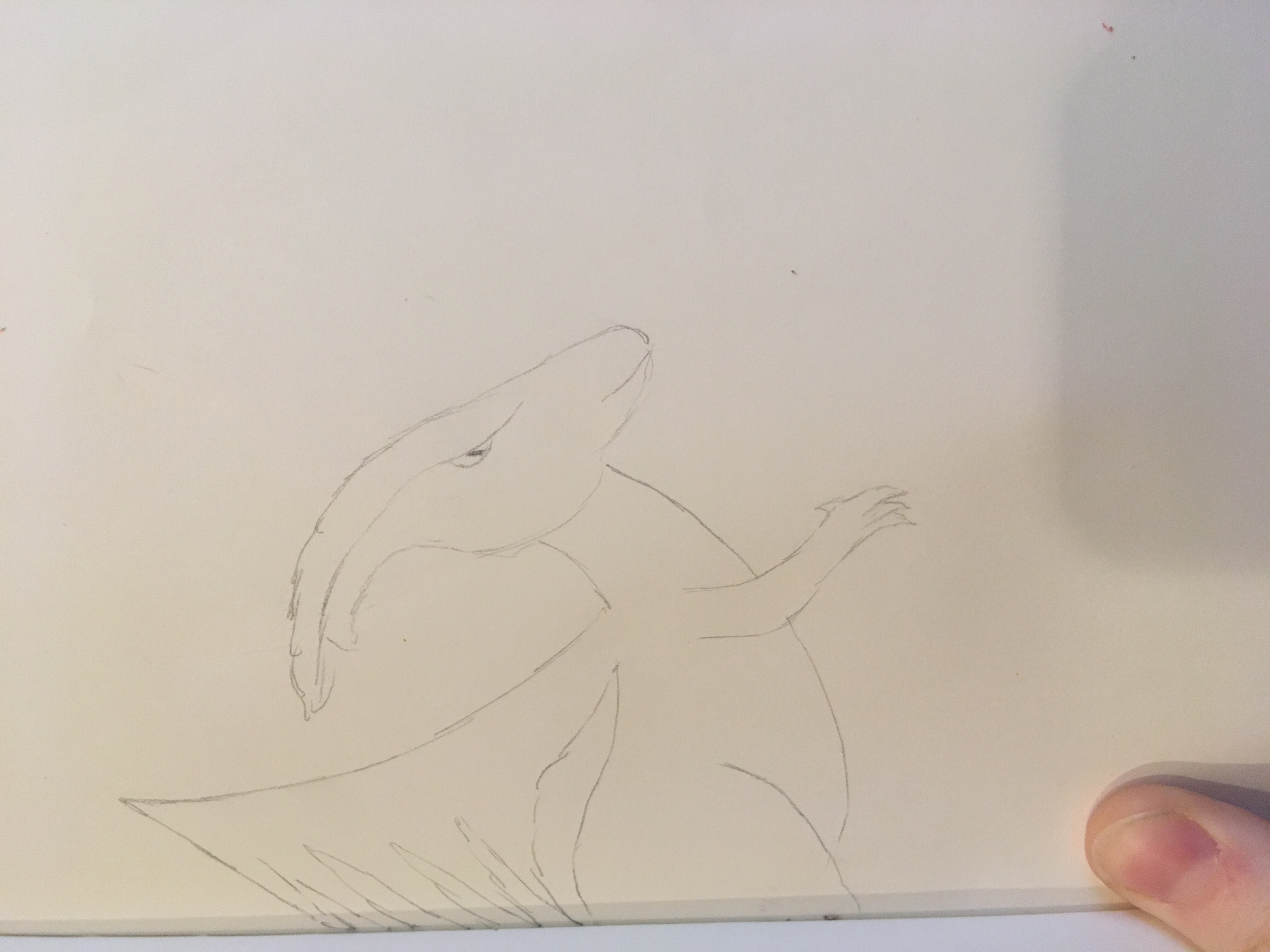 Duckbill dinosaur in pencil on the book I am holding it